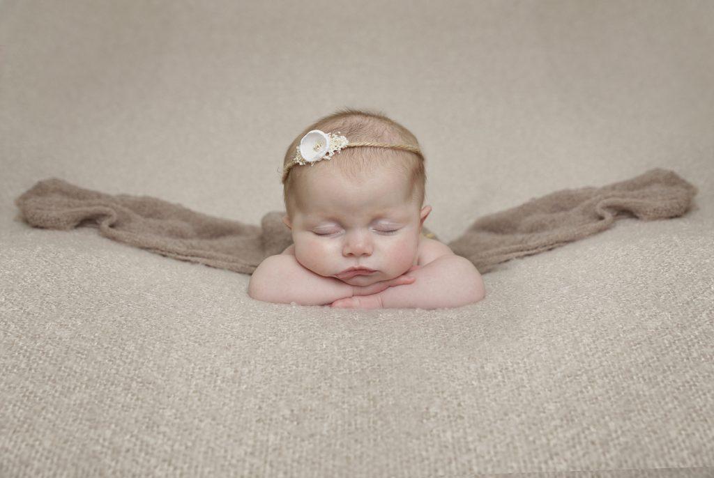 baby girl sleeping with headband by newborn Photographer Dumfries
