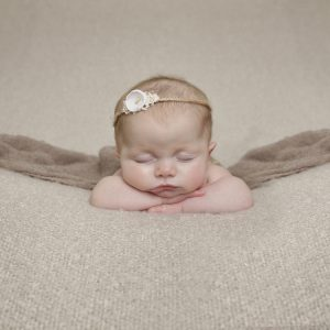 baby girl sleeping with headband by newborn Photographer Dumfries