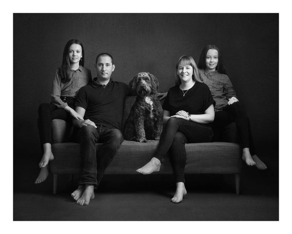 portrait of a family with a dog