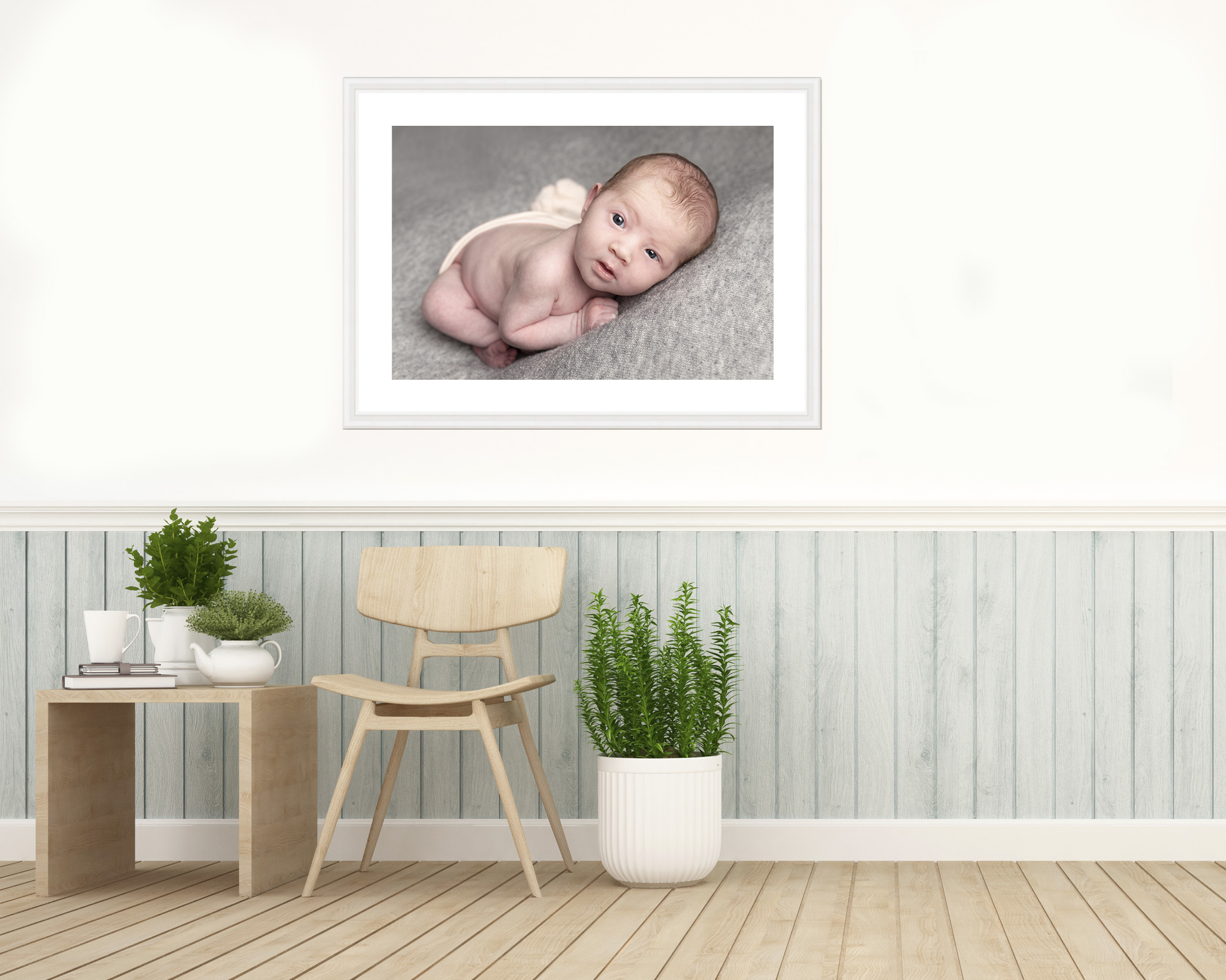 framed image of baby on a wall
