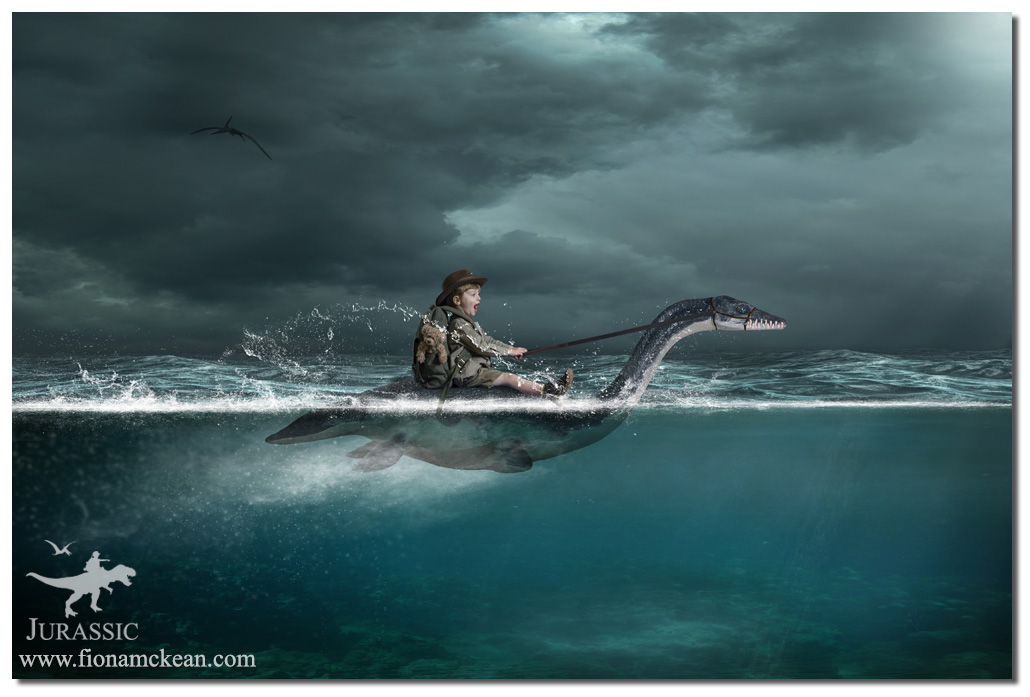 boy in water on back of dinosaur