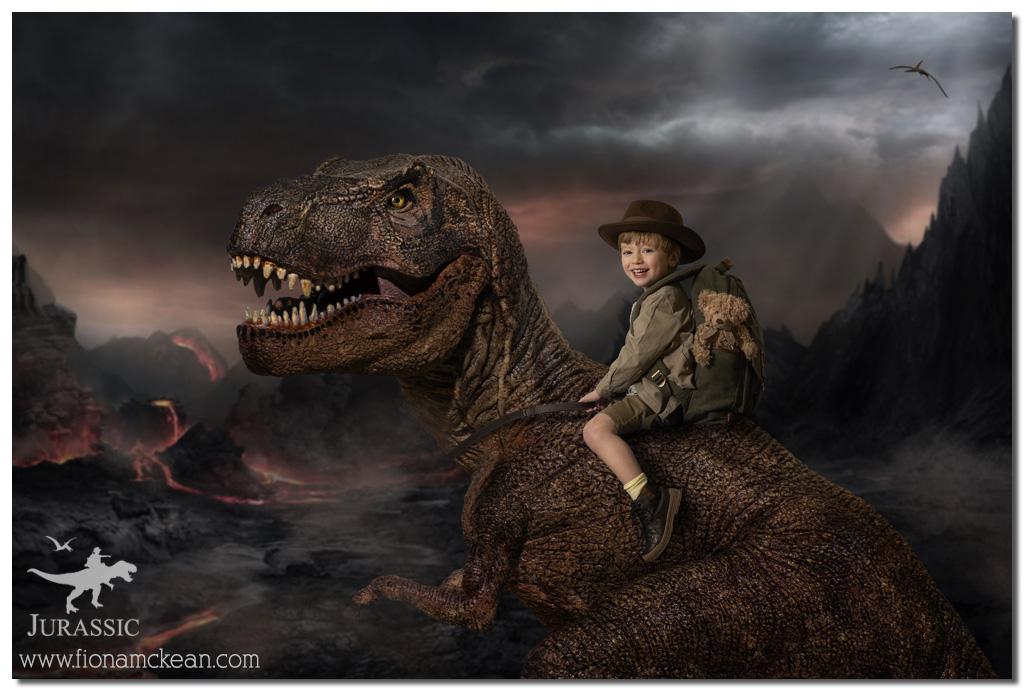 small boy sitting on top a T-rex dinosaur
